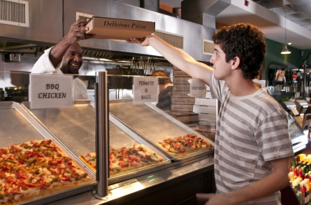 Young adult buying pizza at the restaurant photo