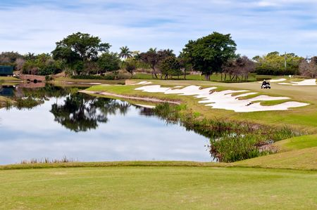 of course: View of lake in golf course in florida.