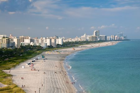 coastline: Aerial View or Miami Beach, condo units and art deco buildings with ocean view.
