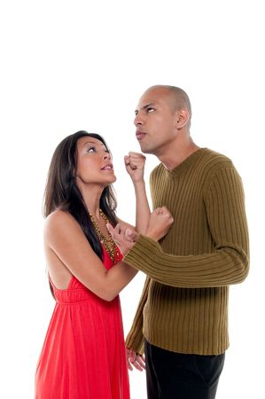 Young couple having an argue very stressed and fighting. photo