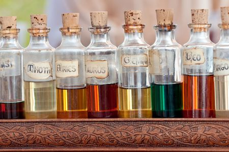 traquility: Bottles with basics oils, essentials and fragances aligned in a street market.