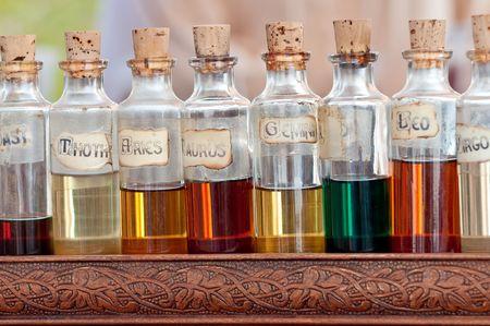essences: Bottles with basics oils, essentials and fragances aligned in a street market.