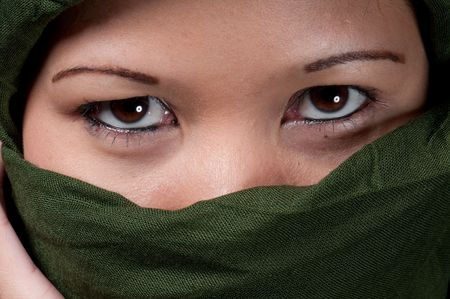 Close up of asiatic woman eyes wrapped in islamic scarf. Stock Photo - 6598091