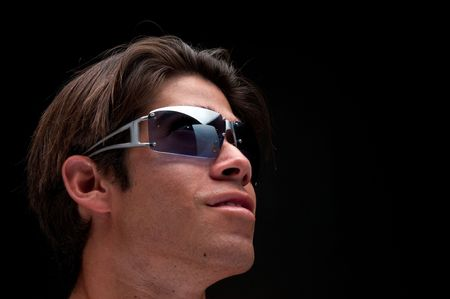 Portrait of young guy with sunglasses. photo