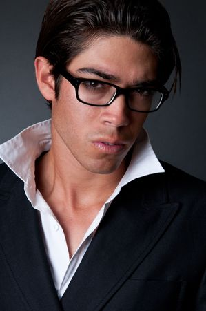 Young trendy man looking serious and pensive. photo