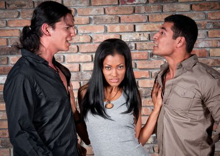 2 handsome guys arguing over a very sensual latin girl.