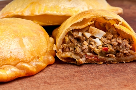 turnover: Beef Empanada fill close up.  The Empanada is a pastry turnover filled with a variety of savory ingredients and baked or fried.
