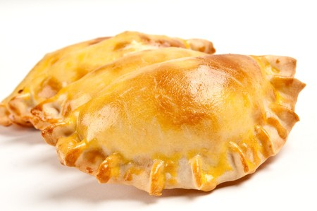 Group of Latin american empanadas. The Empanada is a pastry turnover filled with a variety of savory ingredients and baked or fried. Archivio Fotografico