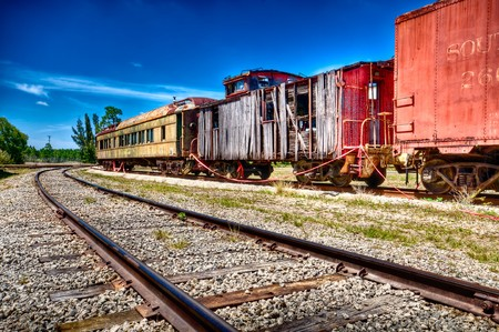 Old and rusted wagon trains over a railway. photo