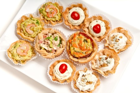 epicurean: Tray full of volauvent canapes ready to serve. Volauvent is a tiny round canapé made of puff pastry. The term  vol au vent  means  blown by the wind  in French.