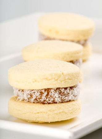 alfajores: Close up of cornflour cookies filled with caramel and coconut. Stock Photo