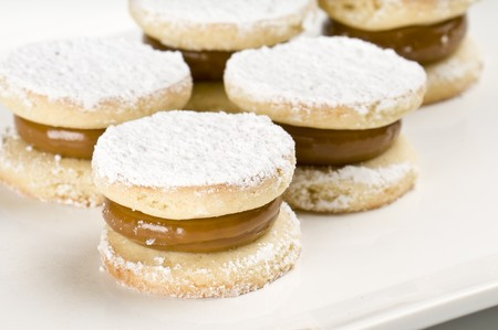 Close up of cornflour cookies filled with caramel. Stock Photo - 8025410