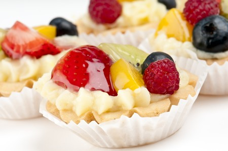 Dessert made of fruit over a voulavent pastry. Volauvent is a tiny round canape made of puff pastry. The term ' vol au vent ' means ' blown by the wind ' in French. Stock Photo - 8025405