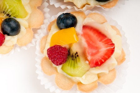 Dessert made of fruit salad over a voulavent pastry. Volauvent is a tiny round canape made of puff pastry. The term  vol au vent  means  blown by the wind  in French. photo