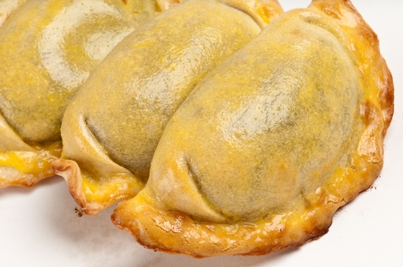 Group of Latin american empanadas. The Empanada is a pastry turnover filled with a variety of savory ingredients and baked or fried. photo