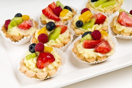 Dessert made of fruit over a voulavent pastry. Volauvent is a tiny round canape made of puff pastry. The term  vol au vent  means  blown by the wind  in French. photo