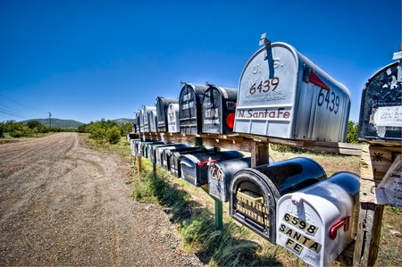 Rural Mailboxes in a dirt street. Wide angle shot.