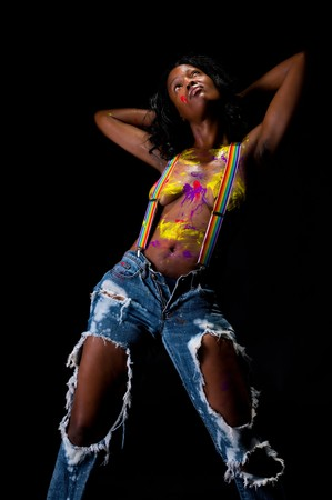Young and sensual african american girl, posing nude and painted.