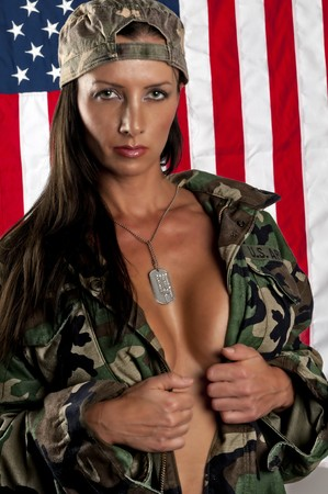 Portrait of woman on her thirties, wearing military jacket, very sensual pose. photo