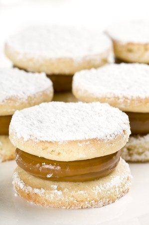 alfajores: Close up of cornflour cookies filled with caramel.