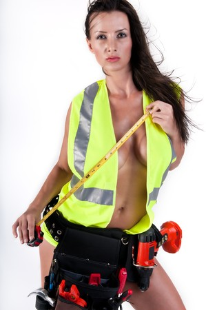 Very sensual woman with safety vest and too playing handyman. All logos removed. Stock Photo - 8025459