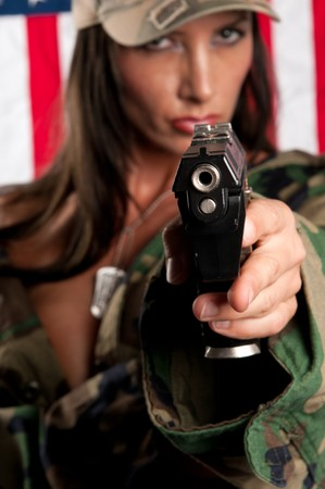 tough: Woman pointing with gun
