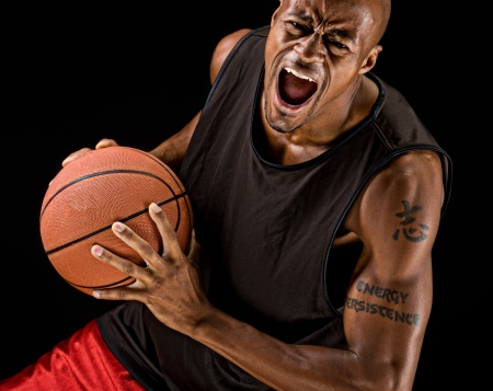 a basketball player: African american basketball player playing strong. Stock Photo