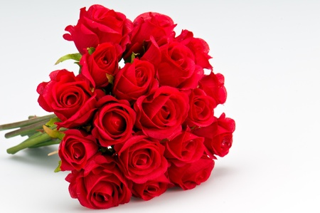rose petal: Bouquet of artificial red roses, isolated, space for copy in the side. Stock Photo