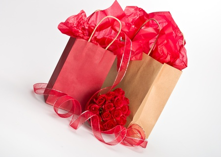 Isolated paper gift bags for saint valentine with rose bouquet photo