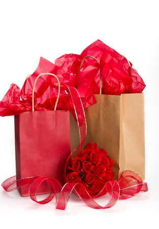 Saint Valentine giftbags presents with roses and ribbons. photo