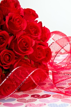 Close up of red roses and red ribbon for Valentines Day. photo