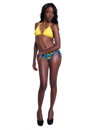 Portrait of very sensual african american in swimsuit white isolated in studio. Standard-Bild