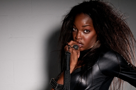 Sensual African American with leather catsuit posing. photo