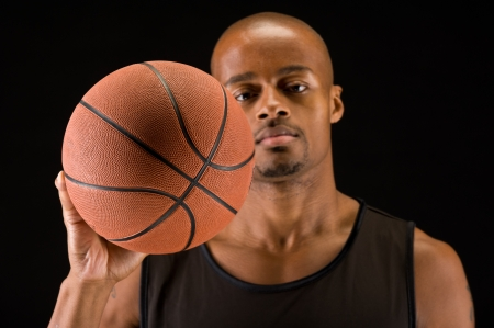 African american basketball player grabbing a ball, use of selective focus.