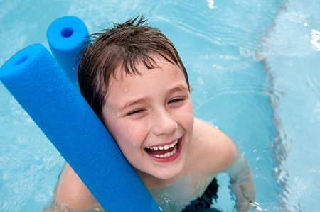 Happy boy in the swimming pool, very cheerful with swimming noodle. Stock Photo - 9695011