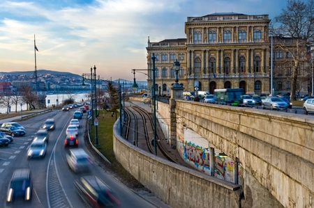 View of the Hungarian Academy of Science and street with motion car bording the Danube. Stockfoto