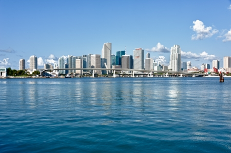 florida: Miami Downtown skyline in daytime with Biscayne Bay. All logos and brand names of building removed.