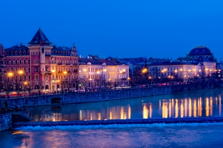 View of Old Town Prague at night and Vlatava River photo