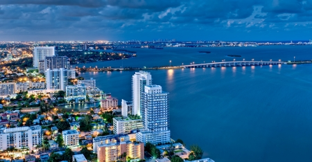 oceanfront: Aerial view of Biscayne Bay and Miami Beach at night. Stock Photo