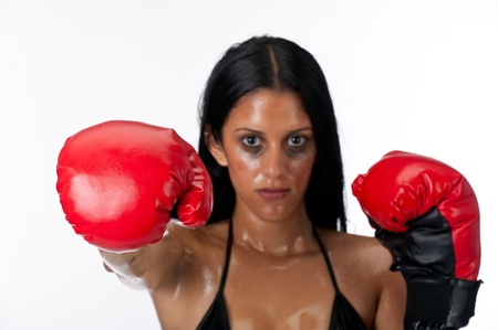 Hispanic woman boxing with gloves  Use of selective focus, focus on the glove  photo