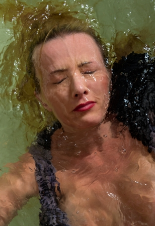 submerging: Portrait of a woman face underwater