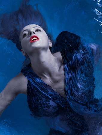 submerging: Portrait of young caucasian woman on water