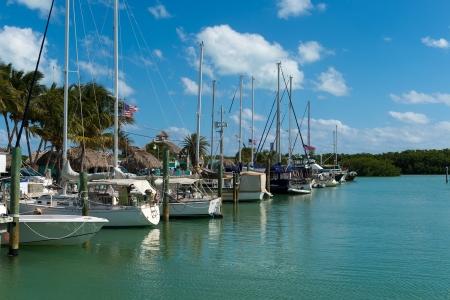 docked: Saliboats docked in a marina in the Florida Keys, a very popular tourist destination. Stock Photo