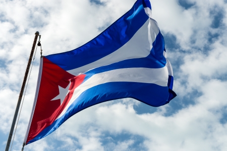castro: Photo of cuban flag against sky in windy day Stock Photo