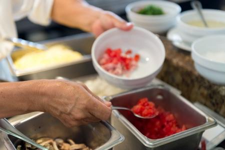 Closeup of hands handling food in kitchen and preparing food Archivio Fotografico