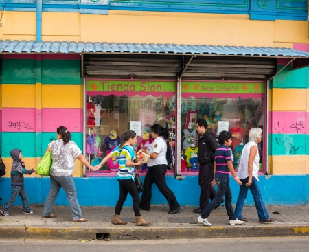 SAN JOSE, COSTA RICA - CIRCA AUGUST 2012  Typical street scene with locals, circa 2012 in San Jose, a very popular tourist destination with 2 2 million foreign visitors a year