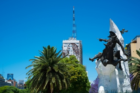 evita: BUENOS AIRES - CIRCA NOVEMBER 2012: View of Monument to El Quijote, in 9 de Julio Ave. Circa November 2012. This avenue is known to be the widest avenue in the world, transversing the city downtowns is route of thousands of workers every day. Editorial