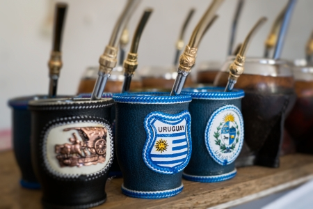 Close up of mate cups with Uruguay flag  Mate is a traditional drink very similar to tea in Argentina, Uruguay, Paraguay and some parts of Brazil  photo