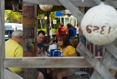 million fish: KEY WEST, FL - CIRCA 2012: Patrons on famous Bos Fish Wagon  a landmark in Key West circa 2012. The tropical city is a popular tourist destination with over 2 million yearly visitors. Editorial