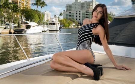 fort lauderdale: Young and sensual caucasian woman relaxing in a bock deck in Fort Lauderdale, Florida  Stock Photo